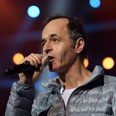 Jean-Jacques Goldman sur la scène d'un concert des Enfoirés en 2015.