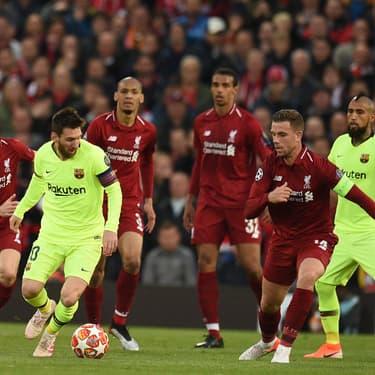 Le meilleur joueur d'Europe et Lionel Messi à la lutte lors de Liverpool - Barcelone, le 7 mai 2019 en Ligue des Champions