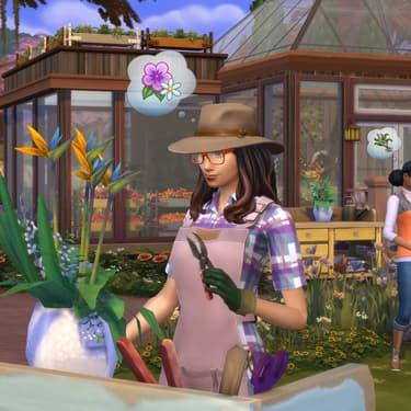 Une Sims en pleine séance de jardinage dans Les Sims 4 Seasons.