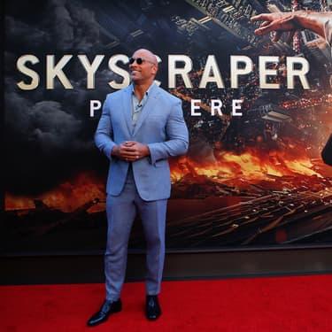 """L'acteur américain Dwayne """"The Rock"""" Johnson, ancien catcheur, à la première du film Skyscraper, en juillet 2018, à New-York."""